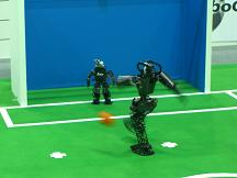 Kidsize robots during penalty kick.